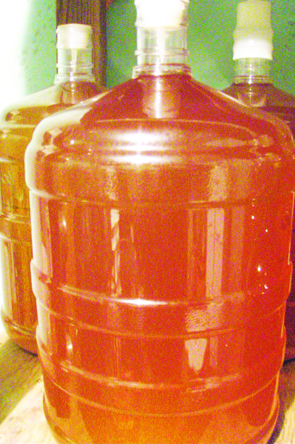 Allow to ferment, usually less than a month. Siphon away from sediment to full containers and replace airlock. Age for 2-3 months and bottle.
